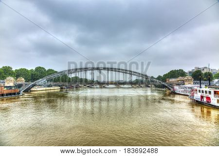 ParisFrance - June 5 2016: Paris cityscape with the River Seine and Austerlitz Bridge during the massive flooding in Paris in the first days of June 2016.