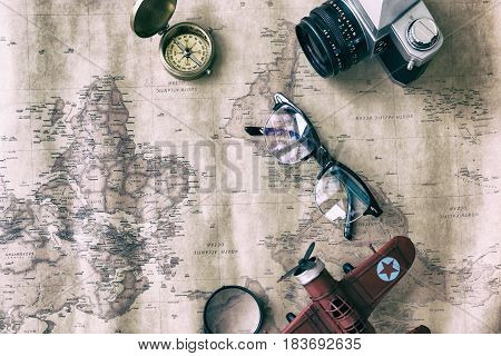 Tourism Planning And Apparel Needed For The Trip On Old Map. Travel Accessories, Eyeglasses, Camera,