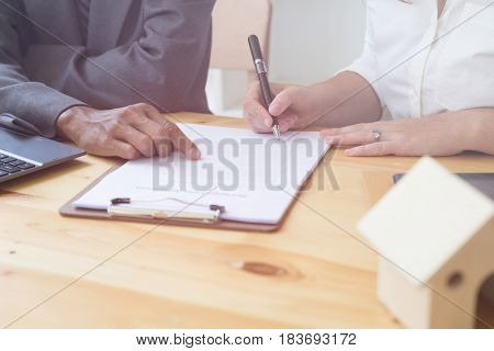 Person's Hand Hold Ballpoint Pen Writing On  Agreement Paper Sheet, Fill In Document Template, Apply