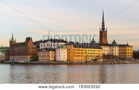 Stockholm - October 2014, Sweden: Evening cityscape of the historic city center in Stockholm and Riddarholm Church (Gamla Stan)