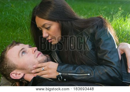 Young caucasian heterosexual couple spending time together at the park