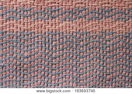 Old pink and blue cotton rug shot close-up for texture