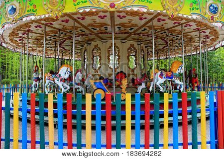 Attractions for children. Bright, beautiful carousel. Horses of different colors attract attention not only children but also adults. Great fun to ride on this carousel.