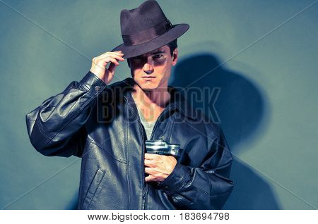 The sexy detective is holding on to his hat.