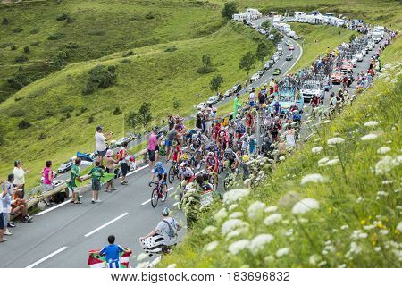 Col de PeyresourdeFrance- July 23 2014: The peloton (Gruppetto) climbing the road to Col de Peyresourde in Pyrenees Mountains during the stage 17 of Le Tour de France on 23 July 2014.