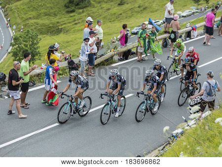 Col de PeyresourdeFrance- July 23 2014: Four cyclists (Kwiatkowski Terpstra Trentin Golas )of Omega Pharma-Quick-Step Team riding in the peloton (gruppetto) on the road to Col de Peyresourde in Pyrenees Mountains during the stage 17 of Le Tour de France o