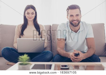 Happy Family Is Sitting In Living Room Spenting Free Time Together. Woman Is Making Online Shopping,