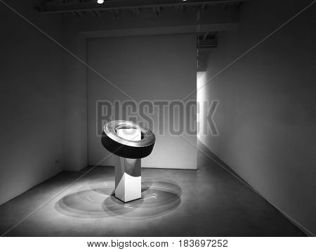 Composition of wheel and empty walls. Empty black and white room and wheel.