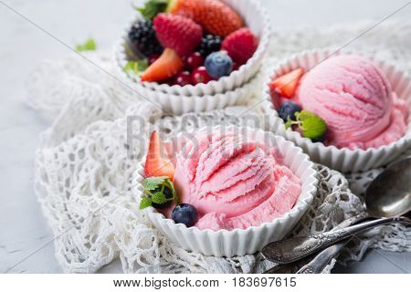 Berry ice cream with fresh fruits, copy space