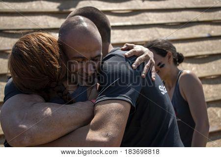 Men And Woman Hugging