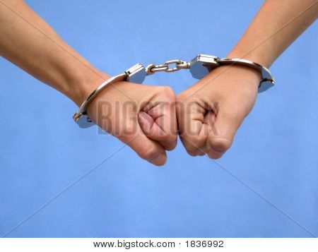 Two Hands In Handcuffs