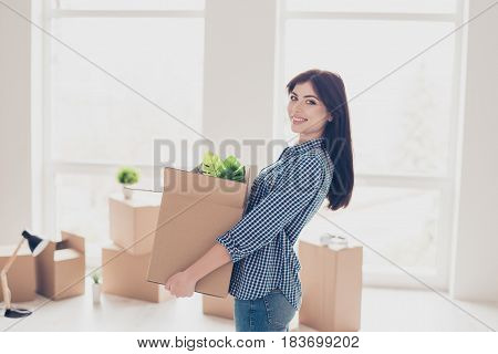 Young Cheerful Successful Woman Moving To New Nice Place And Holding Box With Her Belongings. The Ro