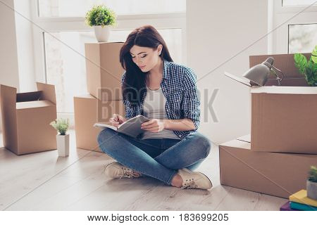 Home, Sweet Home! Young Girl In Casual Clothes Sitting With Crossed Legs On The Floor Of Her New Apa