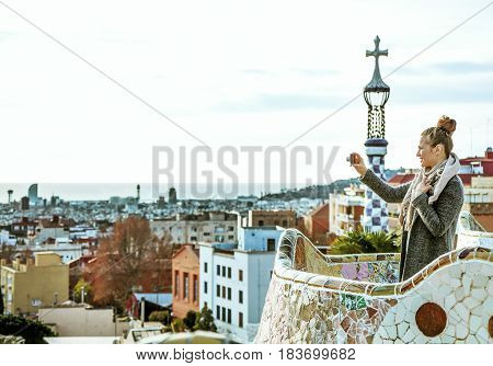 Traveller Woman In Barcelona Taking Photo With Digital Camera