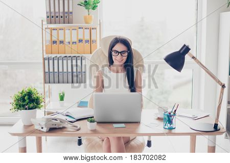 Smart Young Female Professor Is Working In Her Office, It Is Very Modern And Bright. She Is Wearing