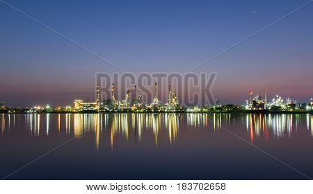 View Of The oil refinery or petrochemical industry in Thailand at before sunrise with reflections