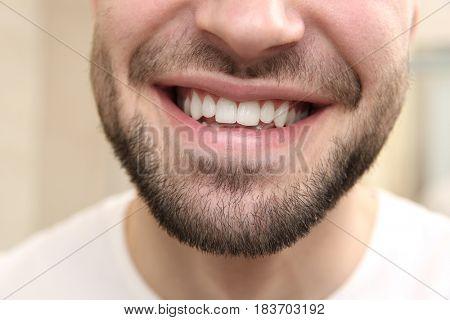 Smiling young man, closeup