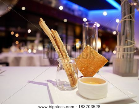Snacks(bread sticks and nacho) are served in fine dining restaurant.