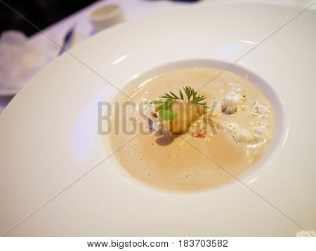 Lobster Bisque with popcorn are served in fine dining restaurant.