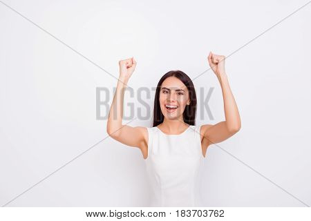 Victory! Excited Girl Is Celebrating Success In White Smart Dress On Snow White Backgroung. She Achi