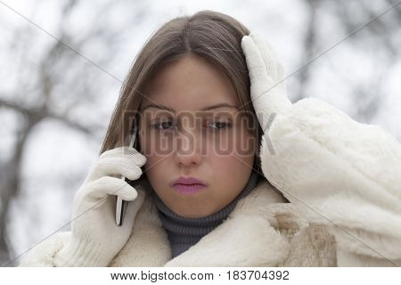 Young Worried Woman Phoning In The Park