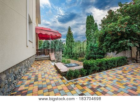Backyard landscape design with cozy patio area. Backyard summer