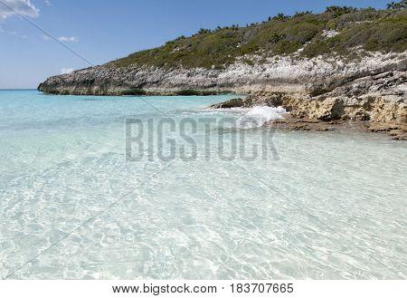 The crystal clear water on uninhabited island Half Moon Cay beach (Bahamas).