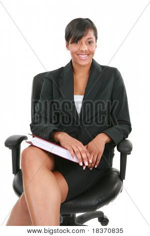 Natural Looking Black Female Businesswoman Sitting on Office Chair Isolated