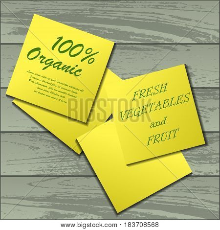 Four yellow stickers with sample text isolated on wooden background
