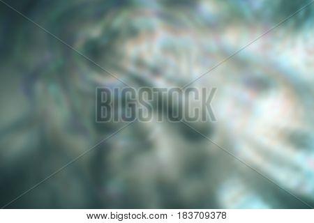 Blurred blue background with lights, asymmetric with dark and light areas
