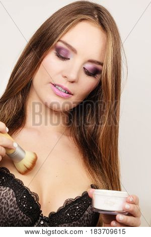 Woman In Lingerie Applying Loose Powder With Brush