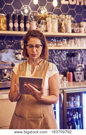 Coffee Shop Owner Checking Her Supplies