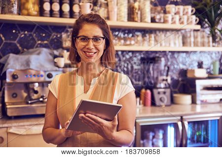 Coffee Shop Employee Smiling At Camera