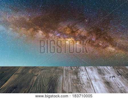 vintage wood terrace with milky way galaxy long exposure photograph with grain image contain certain grain or noise and soft focus soft focus selective focus copy space.