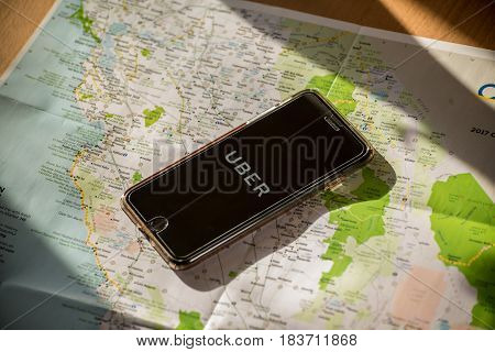 Chicago,IL,USA,Feb-12,2017,Smartphone with Uber application on the screen and a map  (for editorial use only)