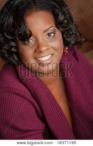 Beautiful African American Plus Size Female Fashion Model in Sweater Headshot