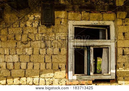Roztots'ka Pastil' Ukraine - April 25 2017: Window of an abandoned old house made of adobe on the outskirts of the village in the south-western Ukraine.