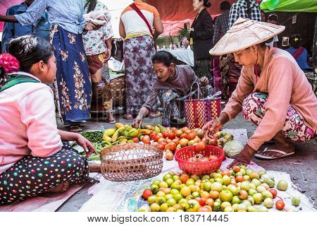 NYAUNGSHWE, MYANMAR- MARCH 5, 2017: People at lokal green market on March 5, 2017 in  Nyaungshwe  Village, Southeastasia, Myanmar. (Burma)