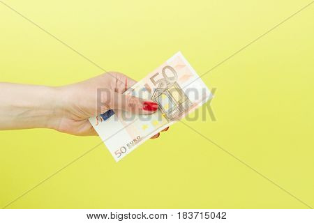 Fifty Euro In The Woman's Hand, Yellow Background