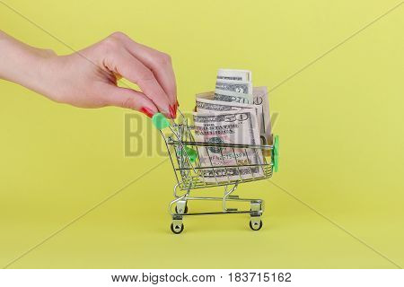 American Dollars In The Shopping Pushcart, Yellow Background