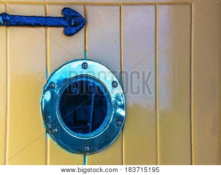 Stylish Door With A Bull's Eye , An Interesting Door In A Seaside Village