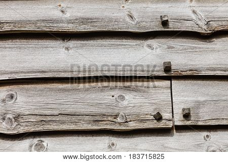 Textures patterns and backgrounds concept. Light old wooden wall detail board closeup