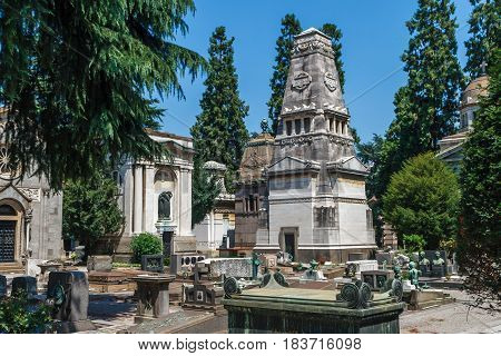 Milan, Italy. Famous landmark - the Monumental Cemetery Cimitero Monumentale at summer sunny day