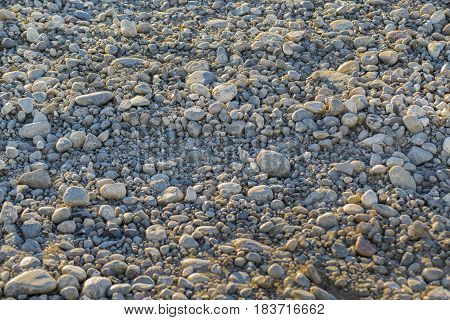 Grey Rounded stones gravel texture background .