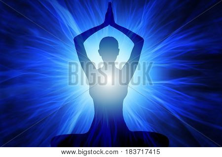 Silhouette of woman doing yoga with rays