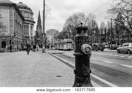 POZNAN, GREATER POLAND / POLAND - 2015: Fire hydrant, trams; Buildings and people in the big city