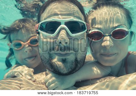 Underwater Portrait Of Family