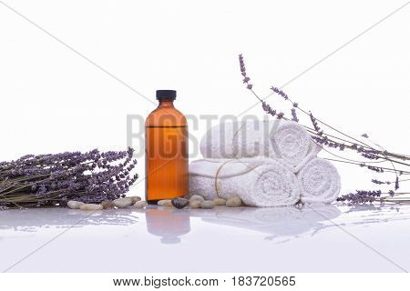 lavender with towel with spa oil for spa setting