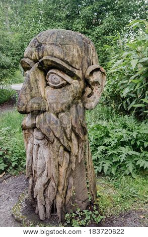 MAINAU ISLAND. GERMANY - JUNE 11 2013: Old wooden sculpture at Mainau island garden. Germany