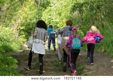 Mothers with children on the walk in forest, walk through forest in spring for your health